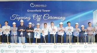 Greenfield District tops off two towers